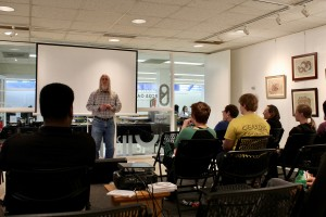 Artist Jimmy Crosthwait addresses students at a Lunch & Learn in the  Ross Gallery.