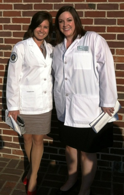 Dominique Garcia-Robles, Chemistry 2011, and Stephanie Johnson, Biology 2009, at their white coat ceremony at the Southern College of Optometry.