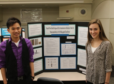 Kevin Pham and Kristin Davis displaying their poster at the BIOL 362 Junior Seminar poster session.