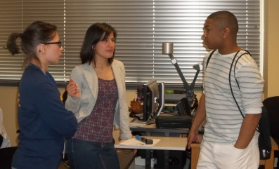 Dominique Garcia-Robles (Left, B.S. Chemistry, 2011) and Kay Powell (Center) are shown talking with Damien Stevenson (B.S., Biochemistry) after the presentation.