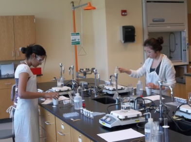 Area high school students are shown working during the Laboratory Section of the National Examination for the Chemistry Olympiad.