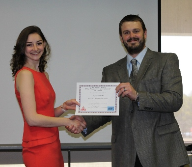 Hope Gilbertson accepting her certificate for 2nd place at the TAS meeting