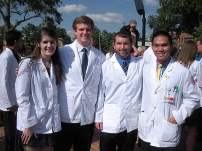 Jessica Ferrell , Biology 2013, Riley Pace, Chemistry 2013, Scott Parker, Biology 2013,  in M1 white coat ceremony on Firday, August 15, at UTHSC.  Joe Fong, Biology 2011, an M2 also joined the CBU grads.  Kell Jeu, Biomedical Sciences 2012, is also an M2 at UTHSC.