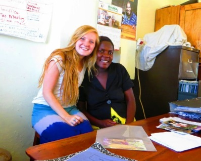 CBU student Daryl Stephens (Psych '14), poses with Susan, secretary, finance and liaisons officer at the Ishaka Health Plan where she did research on Community-Based Health Financing in Uganda