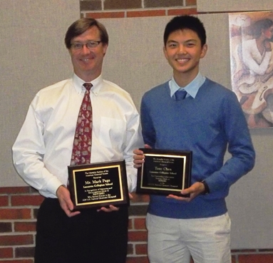 Mr. Mark Page (left) and Tony Chen (right) are shown holding the plaques they received at the Awards Dinner