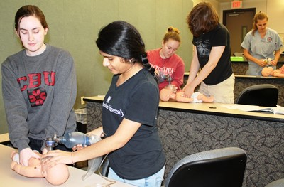 Human Anatomy & Physiology II students learning CPR.