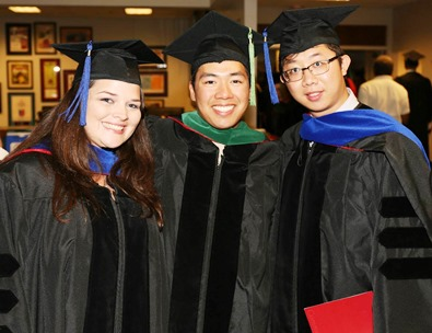 New doctors from the University of Arkansas Medical School: Melody, Coy, and Xiang.