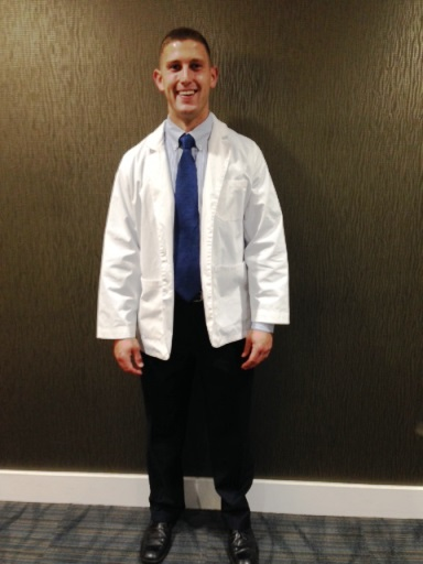 J.D. Wolfe at his white coat ceremony at UAMS.