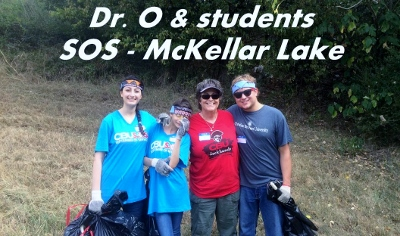 Dr. Ogilvie and some students cleaning up at McKellar Lake